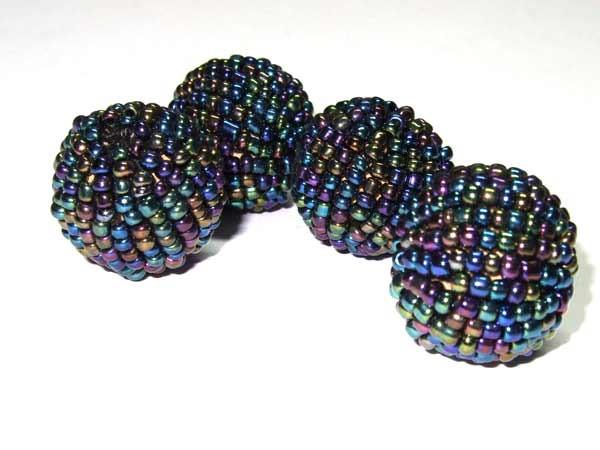 Rocailles Perle schwarzbunt