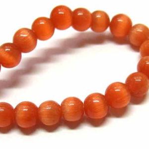 Cateye Perlen Strang 6 mm orange